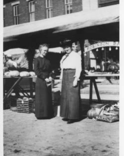 1914 Corn Carnival  Vegetable displays on Main Street. In background is the Robinson & Baker Clothing Store.